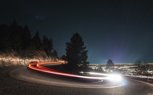night time with a time lapse of a vehicle driving fast