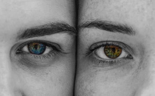 Two faces with different color eyes