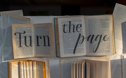 """multiple books open with text overlayed that say """"turn the page"""""""