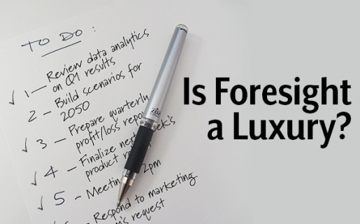 """A paper with words and a pen with text over laid that says """"Is foresight a luxury?"""""""
