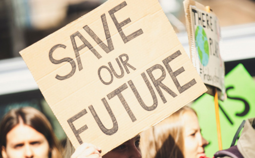 """protestors hold signs that say """"save our future"""""""
