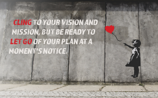 """Graffiti on a city wall of a little girl letting go of a heart balloon with text on top, """"cling to your vision and mission, but be ready to let go of your plan at a moment's notice."""""""