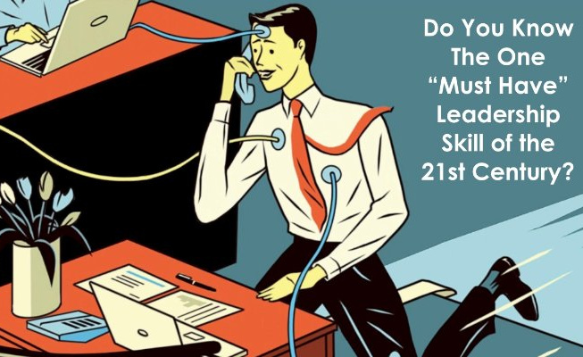 """Cartoon man with tie working at desk with computers connected to body with text that says """"Do you know the one 'must have' leadership skill of the 21st century?"""""""